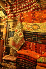 Traditional Hand Woven Textiles Al-Madina Souk An Afternoon in Aleppo, The Ancient City that Was October 31 2010 Syria Middle East (In Memoriam Ngaire Hart) Tags: travel art history tourism wool rock fruit architecture concrete religious photography wooden traffic citadel minaret traditional prayer religion middleeast streetphotography documentary mosque tourist tourists unescoworldheritagesite traveller textures syria souk historical produce bazaar dailylife textiles fortification moat fortress weaving income citizens aleppo hawkers syrian bathhouse suq shopkeeper marked beliefs ngaire ancientcity umayyadmosque orientalrugs camelhair medievalbuilding ceilingdecoration oldwalledcity citadelofaleppo traditionaltextiles eriagn ngairehart almadinasouq syrianstreetfood mpsqueinterior syrianpostbox