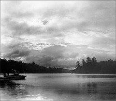 Cottage Lake Scene (Eric Hartke) Tags: blackandwhite filmisnotdead film believeinfilm ilfordfp4 pentaconsix mediumformat square border naturallight cottagelife cottagecountry water bay landscape