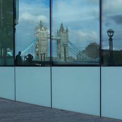 Tower Bridge compressed (Spannarama) Tags: reflections window glass towerbridge distorted morelondon people handsonhead london uk