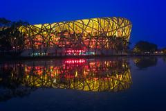 Beijing Olympic Park & Blue Hour (Lus Henrique Boucault) Tags: architeture asia beijing birdsneststadium bluehour china longexposure modern olympicgames2012 reflections stadium travel pequim beijingshi cn