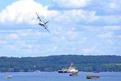 Buzzing the coasties (GLC 392) Tags: mobile bay us united states coast guard navy blue angels fat albert traverse city mi michigan west grand lake water sky cloud trees boat ship marine corps lockheed c130t hercules turning buzzing national cherry festival 2016