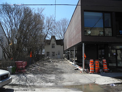 Small house next to new construction - St-Augustin 1 (Vanishing Montral) Tags: history villedemontreal montreal histoire photography art architecture demolition disappearinghistory newconstruction