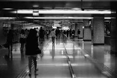 Commuters (VLKong) Tags: ilforddelta3200 ilfotecddx14 pakonf135plus eos1v marinabaysands