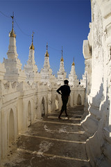 (cherco) Tags: myanmar composition composicion colour color alone solitario solitary lonely boy chico silhouette silueta sky canon cielo walk aloner shadow sombra 5d temple