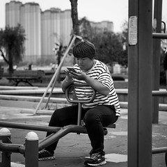 Lost generation (Go-tea ) Tags: canon eos 100d 50mm bw bnw black blackwhite blackandwhithe white street urban city people china chinese asian asia qingdao huangdao park outside outdoor nature portrait woman young fat phone addiction swing generation lost unhealthy example life sports tshirt big lines play sad sorry future priority girl short hair bad exemple