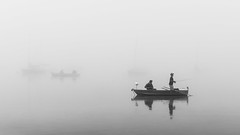 fog fisher (schneider-lein) Tags: mono monochrom black white blackwhite schwarz weiss nebel fog misty see lake fishermen fischer boot boat natur nature greifensee schweiz suisse switzerland swiss carlzeiss sony alpha7ii a7ii ilce7m2 landscape simple reflection reflexion fogfisher fisher