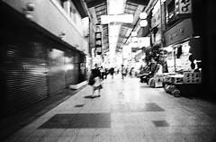 KYOTO 1974 - with my friends - (Jussi Salmiakkinen (JUNJI SUDA)) Tags: people bw blur monochrome japan shop vintage mall 1974 kyoto cityscape sightseeing arcade nostalgia  70s kioto japani       1974  49 roughgrain