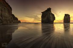 Sisters shadows (bgspix) Tags: sunset sea newzealand sun seascape beach landscape rocks shadows shore nz taranaki 3sisters tongaporutu canoneos5dmarkiii ef1635mmf4lisusm