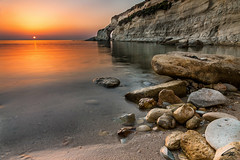 Munxar Sunrise (Explored!!) (glank27) Tags: sea seascape beach rock sunrise canon landscape eos mediterranean arch peace natural malta cliffs pebble filter efs formations graduated haida f3556 marsascala 70d nd09 munxar 1585mm