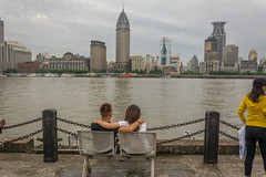 arm-in-arm (stevefge) Tags: china shanghai pudong huangpu rivers water reflectyourworld people candid couple seat bench men women girls architecture skyline riverside