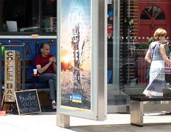 Not the bus stop (paulsvs1) Tags: busstop man woman coffee coffeebar bench rest cigarette break shade ad brooklyn eastwilliamsburg streetphotography urban newyorkcity nyc panasonic dmcfz35 lumix