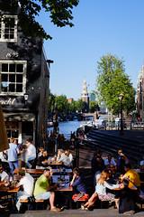 The beauty of Amsterdam during a sunny day (Hans Dethmers) Tags: hansdethmers amsterdam jodenbreestraat cafdesluyswacht sluyswacht caf oudeschans montelbaanstoren color kleur tourist tourists touristen fuji