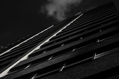 Climbing Upwards (HacksawGeneDuggan) Tags: facade architecture architectural bnw black blackandwhite blackandwhitearchitecture blackandwhitefineartarchitecture fineart building brick brickbuilding highcontrast contrast dark shadows canon canon40d niftyfifty canonef50mmf18ii clouds blackandwhitephotography eugenecampbell photogeneic striking dramatic strikingphotography dramaticphotography highconstrastphotography photography canonphotography windows bnwarchitecture dallas dallastexas texas