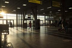 DSC00056 (qwz) Tags: airport simferopol  people street running littlegirl hall shadow floor sun  crimea