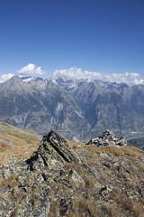 You and the Mountain (vonbueren) Tags: alpen mountains rocks stein fels gipfel bergspitze gras flechten himmel sky bewlkt gebirgskette wallis schweiz switzerland valais wanderung hike wandern wanderweg eischoll alpin
