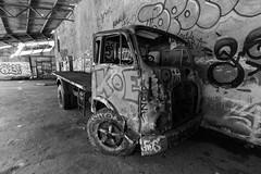 clean me! (leonardShelby00) Tags: consonno ghostvillage bw blackandwhite ruins truck graffiti abandoned