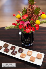 Our chocolates with a charming floral centerpiece with mini pineapples (thewanderingeater) Tags: jacquesgenin paris france patisserie confectioner 3rdarrondissment teahouse