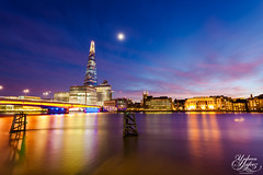 London Bridge (Umbreen Hafeez) Tags: uk bridge blue light sunset england moon building london water thames architecture night buildings reflections river dark twilight europe long exposure dusk low hour gb shard