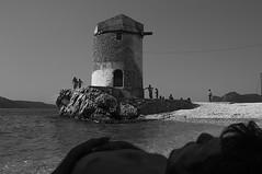 windmill (Vasilis Amir) Tags: boy sea blackandwhite bw beach boys windmill monochrome sleep siesta rest أمير