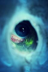 Hole in the fence (danielfagan) Tags: blue macro eye fairytale fence scary outdoor dream spooky fantasy voyeur horror nightmare lucid peepingtom