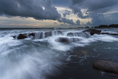 Streams over The Rocks (Pandu Adnyana Photography Tour) Tags: travel sunset bali cloud seascape beach rock landscape waterfall tour wave guide splash mengening balitravelphotography baliphotographytour baliphotographyguide balilandscapetour balilandscapephotography
