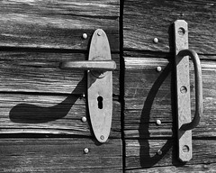 Wood & Steel (Furcletta) Tags: wood shadow white black wall switzerland blackwhite structure nails che doorhandle arosa rills nikonflickraward 70200mm28gvrii