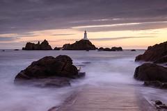 To la Corbire (Torsten Reimer) Tags: lighthouse sunset europa wasser langzeitbelichtung clouds jersey channelislands leuchtturm ocean causeway longexposure ramp sonnenuntergang lacorbire europe rocks sea stbrelade je