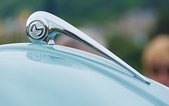 On The Crest Of A Wave (DobingDesign) Tags: morrisminor blue bodywork shiny reflection badge chrome bokeh silver metallic curve shine motorcar vehicle bonnet abstract depthoffield lines shape