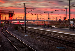 Electrifying Sunset. (ian.emerson36) Tags: sunset station train lightrails golden red signals sky clouds platform virgintrains ecml peterborough england canon 1855mm