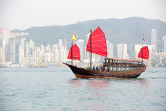 Hong Kong (Patrick Foto ;)) Tags: china city trip travel cruise red sea vacation building classic tourism water ferry architecture sailboat skyscraper port landscape asian hongkong coast harbor boat town wooden asia ship cityscape cloudy flag traditional famous sightseeing chinese vessel victoria tourist historic hong kong transportation highrise sail destination mast concept copyspace rise kowloon