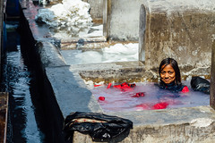 Sitting In a Laundry Stall, Dhobi Ghat (AdamCohn) Tags: india adam girl wash laundry mumbai washing cohn mahalaxmi dhobighat dobighat laundryghat adamcohn wwwadamcohncom