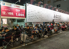 People queueing and sleeping in the street for the opening of a new shop, Kanto region, Tokyo, Japan (Eric Lafforgue) Tags: street city people urban japan horizontal night outdoors tokyo store waiting asia sitting teenagers line indoors queue wait launch adults groupofpeople crowded lined queuing queueing kantoregion campingchair 9people colourpicture largegoupofpeople japan161122