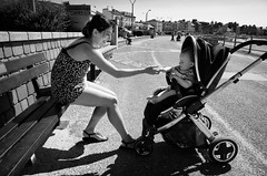 A Mother's Love (nigelhunter) Tags: street urban baby sun smile coast child stroller candid mother promenade morecambe pram lovebench