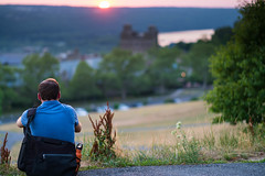 Student Watching Sunset - Cornell University (agladshtein) Tags: cornelluniversity ithaca newyork ny tompkinscounty dusk sunset students sonya7r2 nikkor85mmf18g nature water summer green trees