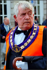 Almost the Boss of Bosses (* RICHARD M (Over 5 million views)) Tags: candid street portraits portraiture candidportraits candidportraiture streetportraits streetportraiture orangemensday thetwelfth orangelodge grandlodgeofengland regalia chainofoffice orangeorder brolly umbrella whitehair whitehairedman seniors pensioners oaps bowtie sidewaysglance iflookscouldkill marches marchers marching parades southport merseyside sefton whitegloves orangeman blacktie loyalorangelodge lol thedecisivemoment