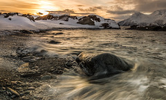 golden moments (christian.denger) Tags: sunset water norway stone canon landscape eos wasser sonnenuntergang norwegen wave lee fjord landschaft stein haida 6d troms 1635 nordheim