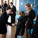 Barrels by the Bay - U.S. Naval Academy Midshipman 3rd Class Megan Rosenberger, 20, left, greets visitors to the announcement of Barrels by the Bay at the Chesapeake Bay Foundation headquarters in Annapolis, Md., on March 23, 2015. As a 2015 Clinton Global Initiative University Scholar, Rosenberger, of Pittsburgh, Pa., was awarded $5,000 in funding for her project, in which 22 donated Coca-Cola syrup barrels will be painted by students from Anne Arundel County schools.