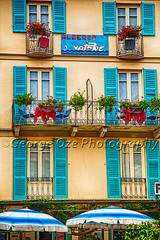 Windows, Balconies on a Small Hotel, Albergo Vapore, Menaggio, Lake Como, Lombardy, Italy (George Oze) Tags: travel blue vacation italy lake vertical architecture landscape outdoors hotel colorful europe mediterranean relaxing scenic shutters balconies daytime quaint lakecomo carefree hospitality europeanunion redflowers parasols albergo lombardy northernitaly pottedflowers menaggio romanctic buildingexteriors shuttersandwindows provinceofcomo albergovapore