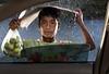 Under the rain (ali darwish233) Tags: lighting boy people rain photography photo poor raining علي تصوير مطر photogarpher إضاءة طفل ناس درويش مصور يبيع تمطر alidarwish