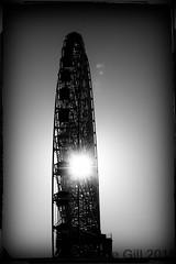 Ferris Wheel (lesliegill) Tags: bw japan december ferriswheel yokohama bushakai
