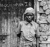 African woman (sandbag the great) Tags: africa door old white man black bus station boat women ship mud kenya african rwanda captain walls uganda lamu slogans matatu 2007 dhow wattle kenyan rwandan
