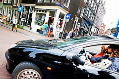 The Only Car in Amsterdam (kirstiecat) Tags: life street people dog netherlands amsterdam reflections outdoors canine moment cinematic