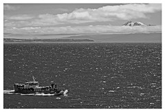 """Freighter, heading out to sea"" - Puerto Montt, Chile (TravelsWithDan) Tags: ocean chile blackandwhite bw mountain volcano boat ship pacific frame freighter"