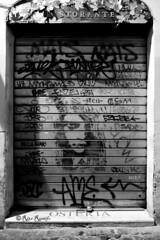 Roma. Trastevere. Street art by Sten (R come Rit@) Tags: italia italy roma rome ritarestifo photography streetphotography streetart arte art arteurbana streetartphotography urbanart urban wall walls wallart graffiti graff graffitiart muro muri streetartroma streetartrome romestreetart romastreetart graffitiroma graffitirome romegraffiti romeurbanart urbanartroma streetartitaly italystreetart contemporaryart artecontemporanea artedistrada trastevere rionetrastevere rione stencil stencilart serranda serrande saracinesca saracinesche portcullis rollingshutters rollingshutter shutter sten bn blackandwhite biancoenero bw night