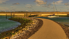 The end of the road,but not for the boat._01 (alex.vangroningen) Tags: sea boat dunes netherlands beach water stones sky clouds road
