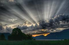 Sunbeams during a beautiful sunset at Iseo Lake (Italy) (Jaco Verheul) Tags: sunset sun sunbeam mountain italy lake iseo cloud orange landscape ngc cloudporn tree nikon d5100 1685mm hdr snapseed sky green divine