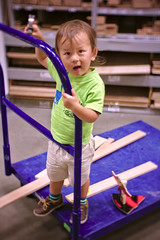 Hammering at Lowe's (Scott SM) Tags: 2 25 year old two toddler hammer lowes cart ride