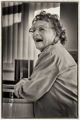 """The best medicine..."" (-Mark Bean-) Tags: monochrome portrait black white bw mono candid natural sepia person people happy fun enjoyment retro vintage smile laugh laughter laughing chuckle giggle street diner 40s 50s family memory memories old age pensioner classic woman"