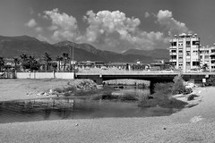 Alanya (awbaganz) Tags: alanya turkey beach clouds bw fuji xe1 xf27 river bridge palm house mountain