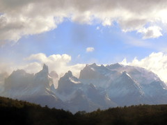 Cloud opening over beautiful mountain peaks (Germn Vogel) Tags: latinamerica southamerica chile chilesouth surdechile patagonia torresdelpaine nationalpark mountain andes nature naturallandscape landscape cloudy sky beautiful outdoor exploration hiking horns peak travel traveldestinations traveltourism tourism touristattraction